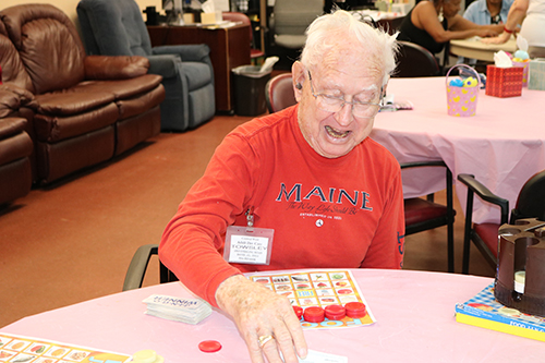 Thomas Towsley enjoys a game of fruit bingo, a creative spin on the classic bingo. The game is frequently played at the adult day care center in Davie operated by Catholic Charities to get clients involved and challenged.