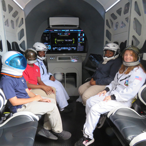 Waiting for lift-off: St. Ambrose School students sit inside the cabin of the Experium Space Colony Mission spaceship. The rocket simulator gave students the opportunity to participate in a hands-on mission on Mars.