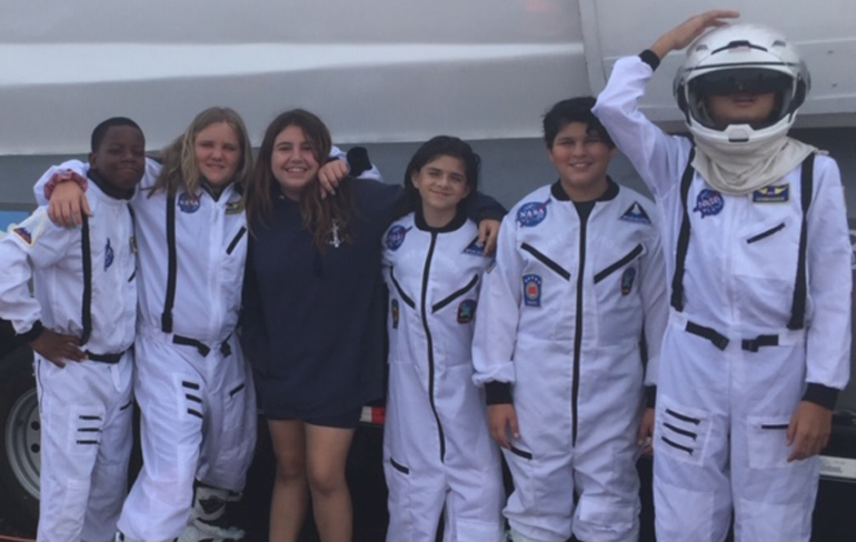 Astronaut couture: Students from St. Ambrose School are dressed and ready to go as astronauts on the Experium Space Colony Mission. May 7 and 8,  the STEM (Science, Technology, Engineering and Math)-like escape room and simulator gave students the opportunity to fly to Mars and solve missions on the red planet.