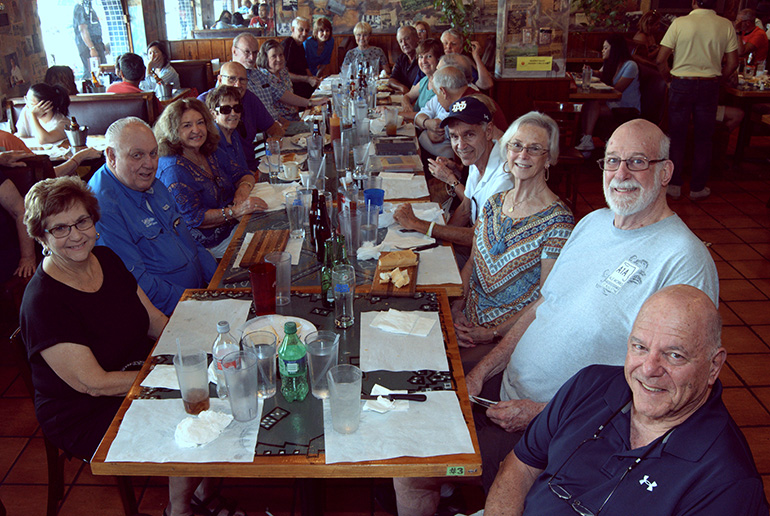 Alumni of Sts. Peter and Paul School gather for lunch in Miami during their 70th anniversary reunion.