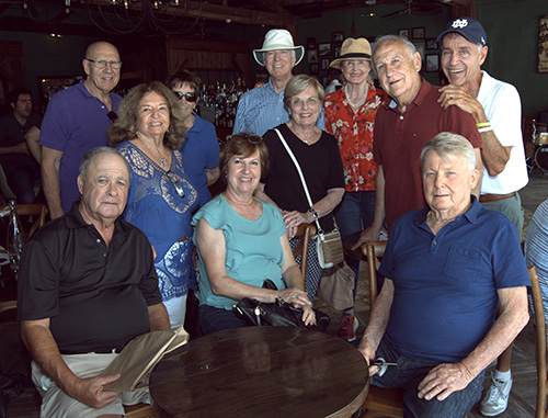 Alumni of Sts. Peter and Paul School visit a favorite bar and music hall during their 70th anniversary reunion.