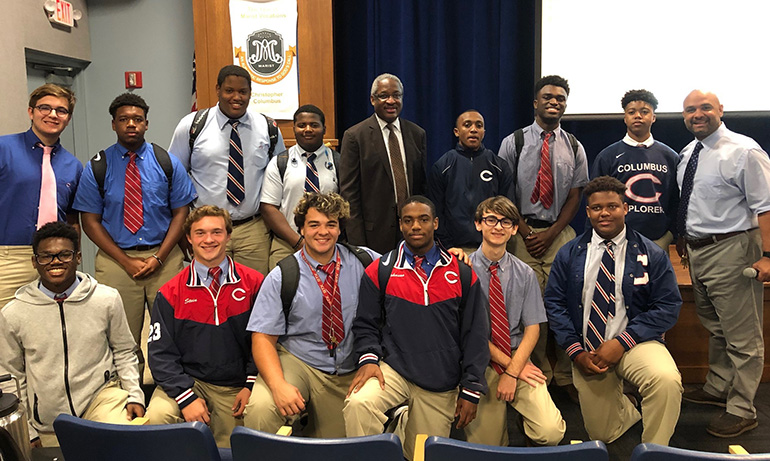 Albert Dotson Jr., real estate attorney and vice chair of 100 Black Men of America, Inc., poses with some of Christopher Columbus High School's students during a visit and talk at the campus for Black History Month. At far right is social studies lead teacher Alex Trujillo, who felt inspired to start the lecture series.