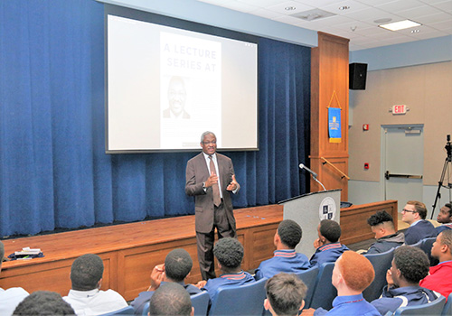 Albert Dotson Jr., real estate attorney and vice chair of 100 Black Men of America, Inc., speaks to Christopher Columbus High School students as part of a new lecture series to mark Black History Month.