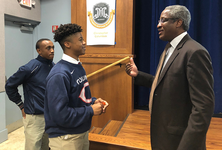 Albert Dotson Jr., real estate attorney and vice chair of 100 Black Men of America, Inc., talks with Christopher Columbus High School's Garrelleon Riley as fellow student Joseph Luisias looks on. Dotson was one of a series of local professionals  who shared their inspirational and motivational stories at a new lecture series marking Black History Month.