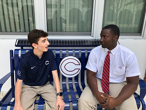 Harrison Dunbar, left, and Jeramy Passmore discuss what they learned from speakers at Christopher Columbus High School's new lecture series marking Black History Month.