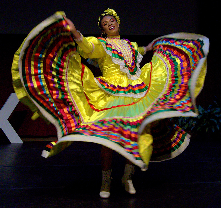 May Basse, a teacher at St. Thomas Aquinas High School in Fort Lauderdale, does a Mexican-style dance during TEDx, a recent forum of speeches and performances at St. Thomas Aquinas High School in Fort Lauderdale.