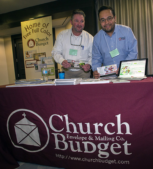 Brooke Pidgeon and Heriberto Pimentel pose at the Church Budget electronic giving display. They were among the exhibitors at the second Florida Statewide Stewardship Day, held May 4, in downtown Miami.