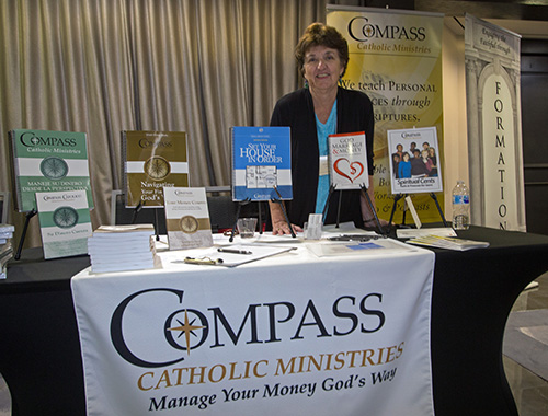 Evelyn Bean, co-founder with her husband of Compass Catholic Ministries, poses at her display at the second Florida Statewide Stewardship Day, held May 4 in downtown Miami.