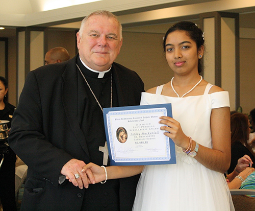 Archbishop Thomas Wenski poses with St. Bernadette eighth-grade student Ashley Muckunlall, one of three scholarship recipients awarded $ 5,000 to attend a Catholic high school. The award was presented at the Miami Archdiocesan Council of Catholic Women's Scholarship Award Luncheon, held during the group's 61st annual convention, May 18 at the Miami Airport Hilton.