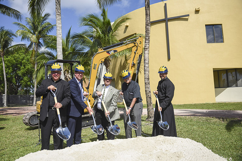 Jesuit Father Guillermo Garcia-Tuñón, president, and other school officials turns spades at the groundbreaking and blessing of the cornerstone for Our Lady of Belen Chapel at Belen Jesuit in Miami.