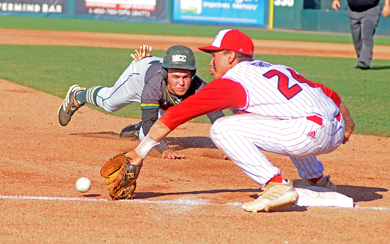 Cardinal Gibbons third baseman Felix Torres reaches for a throw from left fielder Tim Manning (unpictured) to tag out Melbourne Central Catholic runner Cam Maruzzella during the seventh inning of their Florida Class 5A baseball state championship game May 30.