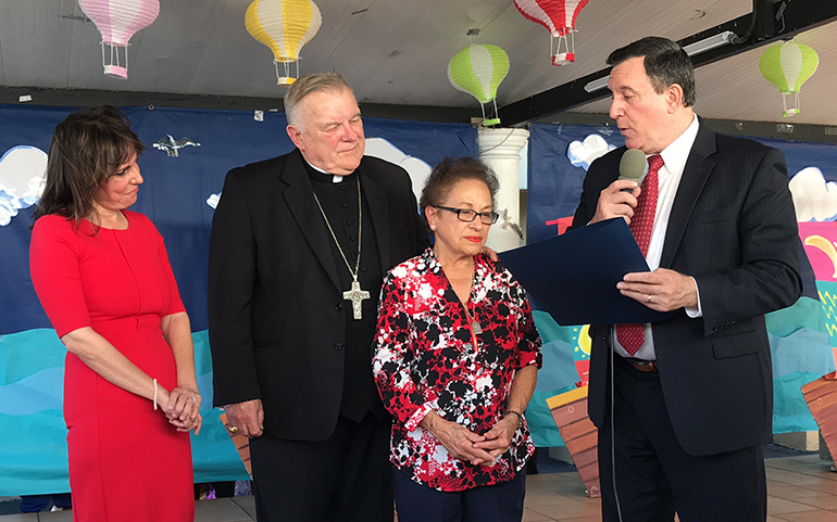 City of Miami Commissioner Joe Carollo presents a Certificate of Merit to Clara Gesni, a Centro Mater teacher who is about to retire after over 30 years of service to the children and families served by the organization. Looking on, from left, are Madelyn R. Llanes and Archbishop Thomas Wenski.