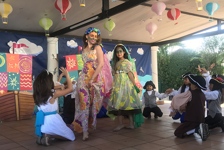 "Children from Centro Mater's theater program surround Ingenio Teatro's Rocio Alvarez during a performance of ""Legends of Discovery,"" a play which centers on the discovery of America. The local theater company and child care center have been working together for over two years."