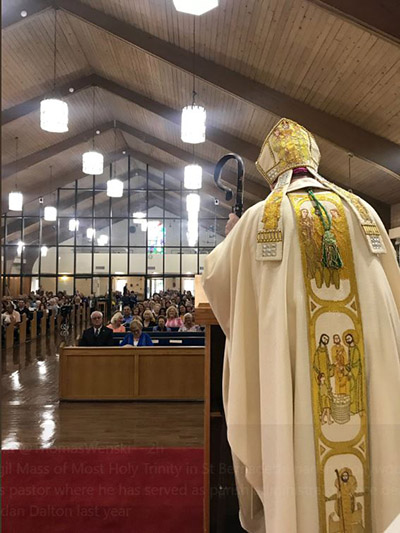 Archbishop Thomas Wenski preaches the homily during the Mass where he installed Father Bryan Garcia as pastor of St. Bernadette Parish in Hollywood, June 15, 2019.