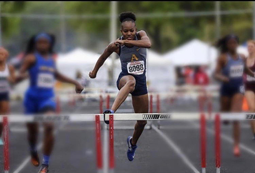 St. Thomas Aquinas' Emelia Chatfield set a state-meet record in the 300 hurdles in 41.34, just off the state-best 41.15 she ran in regionals.