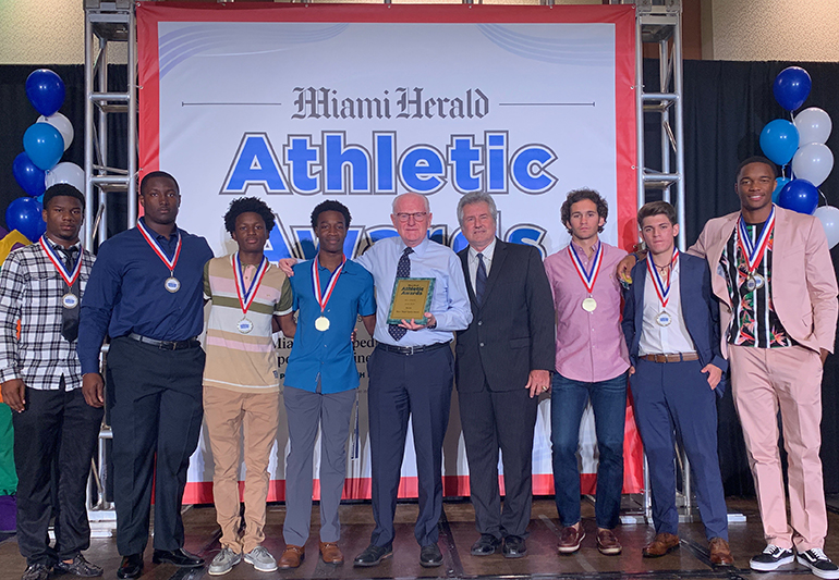 Columbus athletes and coaches pose at the Miami Herald All Dade Breakfast, where all First Team All-Dade athletes, scholar athletes and coaches were honored. Athletic Director  Chris McKeon and the whole program won the 9A-7A boys' major sports award after defending the school's track and field state title, finishing as state runner-up in football and winning the Greater Miami Athletic Conferences in both baseball and soccer. In all, Columbus had 24 student-athletes recognized including Henry Parrish, Jr. (Football Offensive Player of the Year), Nick Regalado (Pitcher of the Year), Nicholas Suarez (Scholar Athlete) and Gary Cooper (Athlete of the Year Finalist).