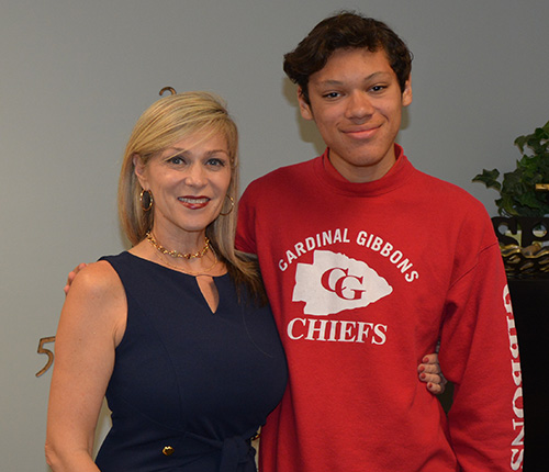Lori Kubach, assistant principal of academics at Cardinal Gibbons High, poses with junior William Gonzalez, who got a perfect score of 36 on his first attempt at the ACT college admissions test.