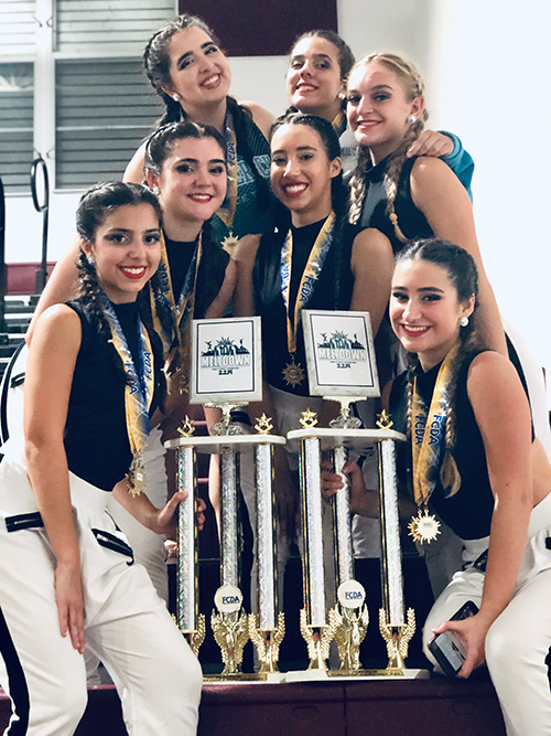 Archbishop McCarthy High School's small varsity jazz and hip hop squad is pictured here with the first place trophy they earned at the Florida Cheer and Dance Association's Miami Meltdown competition in February.