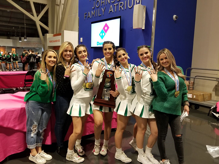 "The ""Original Four"" members of St. Brendan High School's cheerleading team - all 2019 graduates - pose with their coaches, including head coach Arlenee Suarez, second from left, after winning their fourth straight state championship. The Original Four are Daniela Caballero, Katiya Pedrouzo, Melanie Regueyra and Meagan Nasco. The other coaches are Cecilia Esteban and Victoria Salazar."