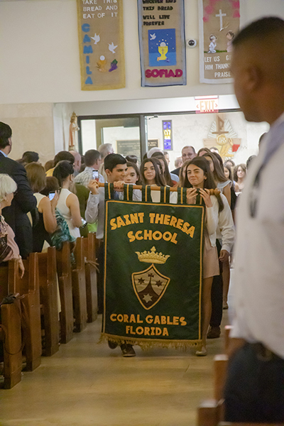 Students from St. Theresa School process into St. Agnes Church, Key Biscayne, for the All Catholic Conference All Star Mass.