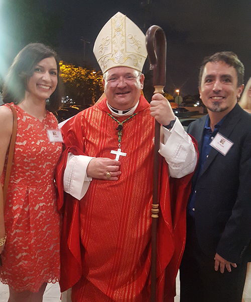 Cristina Cabrera Jarro and her brother, Felipe Cabrera Jarro, pose with Bishop Peter Baldacchino after their Confirmation ceremony at Immaculate Conception Church in Hialeah.