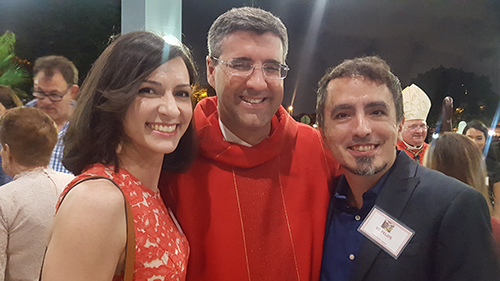 Cristina Cabrera Jarro (left) and her brother Felipe Cabrera Jarro (right) pose with Father Manny Alvarez after their Confirmation ceremony at Immaculate Conception Church in Hialeah.