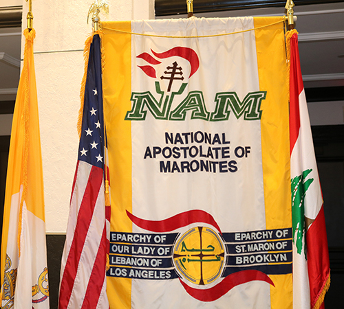 A National Apostolate of Maronites banner is part of displays at the Maronite Convention held in Miami June 26-30 at the Loews Hotel. The members of the apostolate assist the bishops, help bring Maronite laity in the United States together, and help strengthen the bonds between clergy and lay. The group sponsors the national convention each year. This year marks the convention's 56th year.