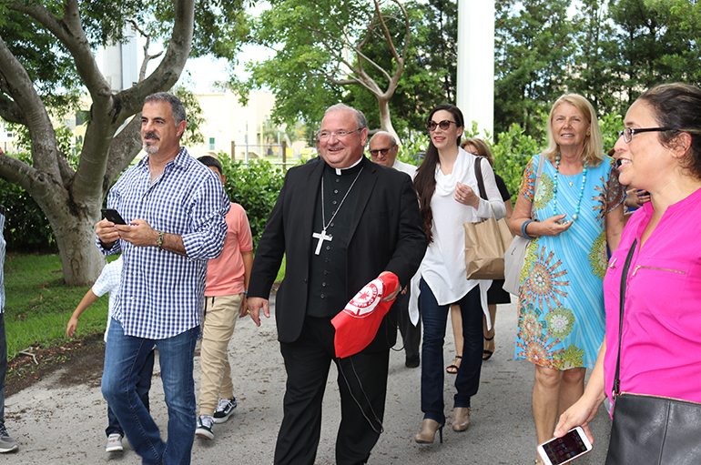 Bishop Peter Baldacchino walks with his St. Kieran parishioners to the Knights of Columbus Council 1726 Hall, located around the corner from the church. That's where they hosted the farewell celebration for their pastor as he leaves for his new assignment as Las Cruces' new bishop.