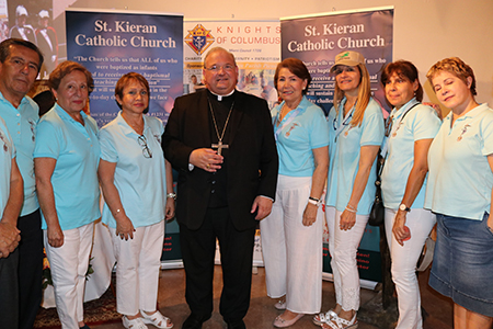 Members of St. Kieran's Legion of Mary pose with Bishop Peter Baldacchino during the farewell party thrown for him by parishioners. In addition to serving as Miami auxiliary bishop, he also served as St. Kieran's pastor since 2014.