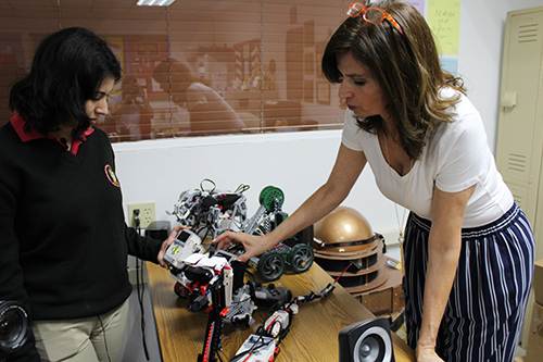 Bring in the robots: Msgr. Edward Pace High's Vanessa Perez Robles, left, works with computer science teacher Hedda Falcon on robots built from Legos. Falcon was a mentor to Vanessa and encouraged her to apply for the Amazon Future Engineer Scholarship she ultimately won.