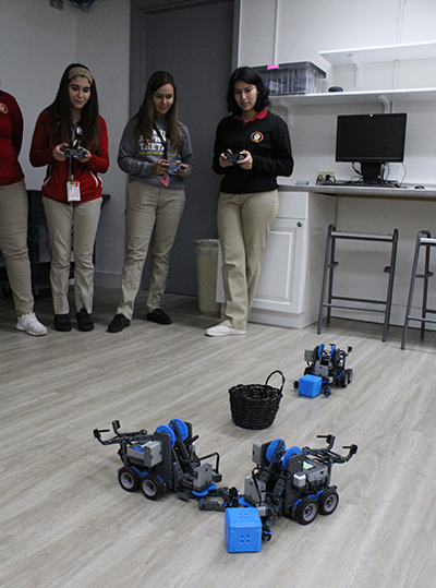 Girls in control: Members of the Women in STEM (Science, Technology, Engineering and Math) Club at Pace work together on a robotics exercise. From left: rising seniors Kaylee Gonzalez, Guadalupe Diaz, and 2019 grad Vanessa Perez Robles.