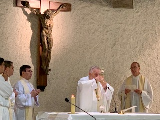 "Archbishop Thomas Wenski celebrates a ""healing Mass"" July 4, 2019, at a chapel dedicated to St. Joseph in Lourdes, France. With him, from left, are Miami priests Father James Arriola, Father Juan Carlos Salazar and Father Omar Ayubi, as well as Msgr. Kenneth Schwanger, far right, pastor of Our Lady of Lourdes Parish in Miami."