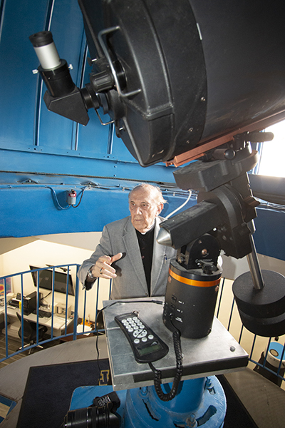 "Jesuit Father Pedro Cartaya describes the attributes of Belen Jesuit Prep's observatory in Miami while standing next to the telescope. Belen is the only school in the United States equipped with a 16"" telescope with a CCD (digital) camera for astrophotography."
