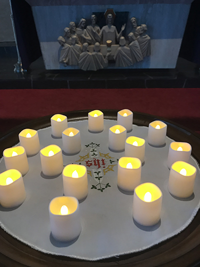 Seventeen candles -- one for each of those killed during the mass shooting at Marjory Stoneman Douglas School -- are placed before the altar at St. Jerome Church during a memorial service in 2018.