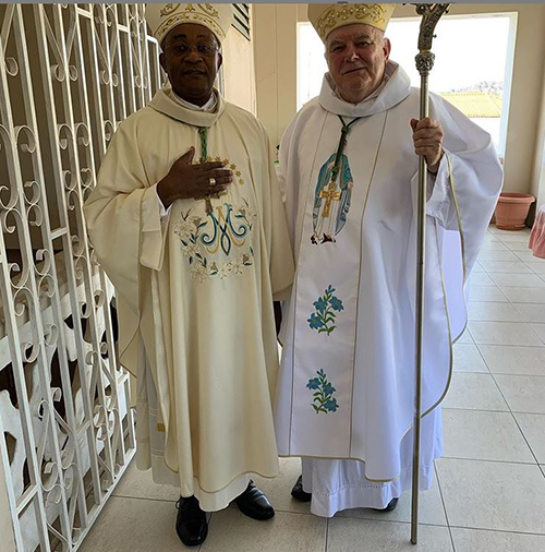 Archbishop Thomas Wenski poses with Cap Haitien Archbishop Launay Saturné before celebrating Mass there on the feast of the Assumption, patroness of the Haitian archdiocese.