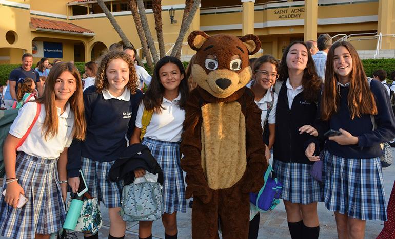 St. Agnes eighth graders, from left, Delfina Pellegrini, Maria Trapani, Maria Paz Escallon, Andrea Montaner, Nicole Beteta and Ines Saudino pose with the school's mascot, Nathan the Bear.