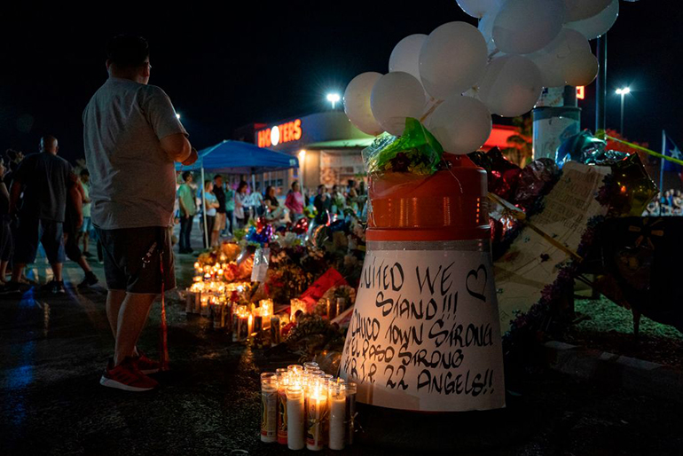 Locals of El Paso visit the memorial for shooting victims at the Cielo Vista Mall Walmart in El Paso, Texas on August 8, 2019. The El Paso community is still reeling from the trauma of the mass shooting which left 22 dead and dozens injured.