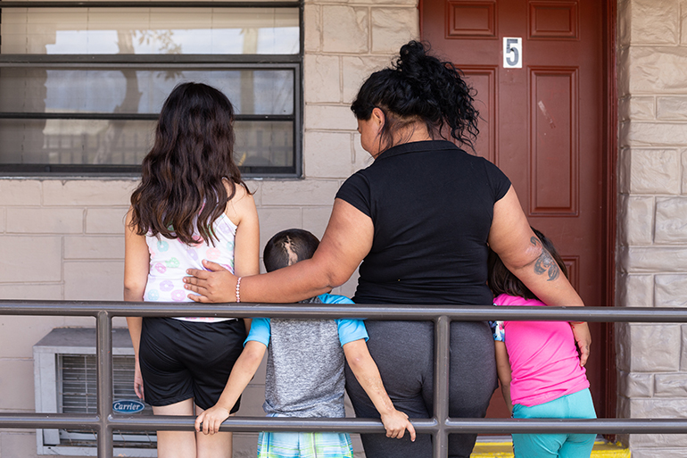 A mother and her three children relax on a quiet weekend at New Life Family Center, a Catholic Charities emergency shelter serving homeless families in Miami-Dade County. The families are provided the services they need to move into permanent independent living and self-sufficiency.