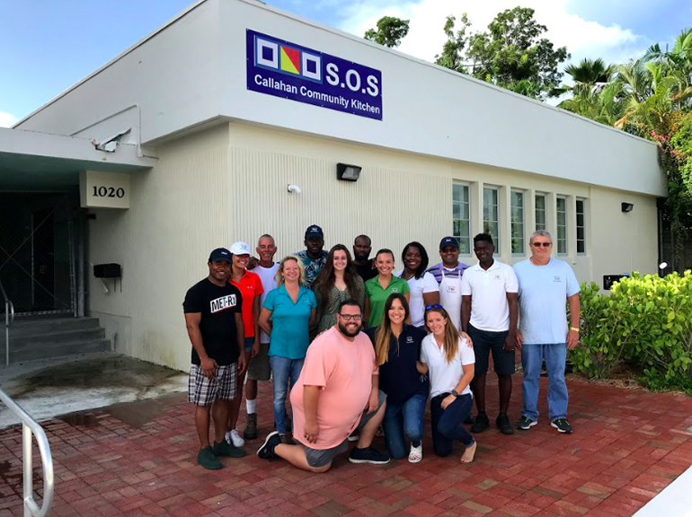 Volunteers and staff, including four archdiocesan seminarians, pose for a photo outside the SOS Callahan Community Kitchen, one of several outreach programs sponsored by the Basilica of St. Mary Star of the Sea in Key West. The kitchen, located behind Key West's city hall, was dedicated in December 2018.