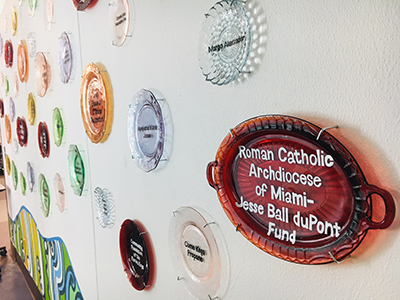 The recognition wall at the SOS Callahan Community Kitchen notes the contribution of the Archdiocese of Miami, which facilitated a grant from the Jessie Ball Dupont Foundation. The kitchen is an expansion of the outreach programs sponsored by the Basilica of St. Mary Star of the Sea in Key West. Located behind Key West's city hall, the kitchen was dedicated in December 2018.