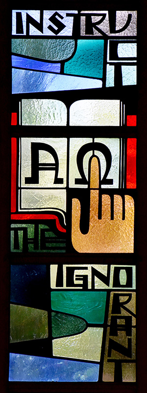 Windows along the side walls remind worshipers how to follow Jesus' commands. This one urges them to