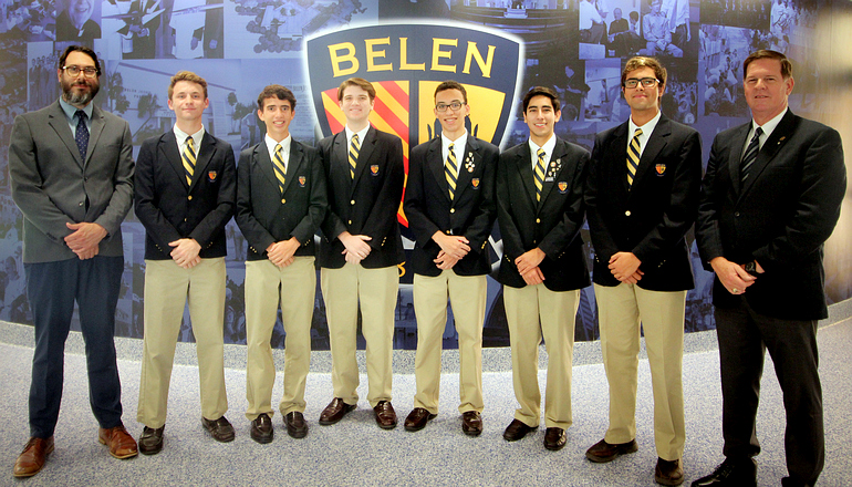 Six students of the Belen Jesuit Preparatory School in Miami, chosen as National Merit Scholarship semifinalists, pose with school officials. At left is assistant principal Ramon Nicosia, with principal Jose E. Roca at the right.