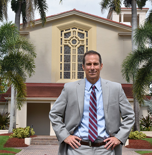Mike Allen pauses outside the Cor Jesu Chapel at Barry University, where he was chosen this year as its new president.