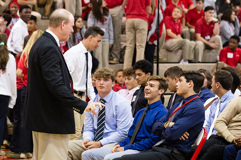 Thomas E. Mahon, president of Cardinal Gibbons High School in Fort Lauderdale, speaks to students before the start of a Mass for the opening of the new school year Aug. 22. Archbishop Thomas Wenski president at the liturgy at the school's campus.