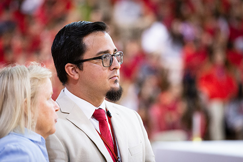 Oscar Cedeño, principal of Cardinal Gibbons High School in Fort Lauderdale, is shown before the start of a Mass for the opening of the new school year Aug. 22. Archbishop Thomas Wenski president at the liturgy at the school's campus.