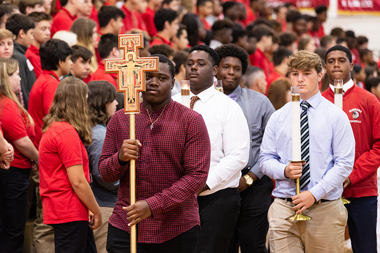 Members of the football team at Cardinal Gibbons High School in Fort Lauderdale helped organize the opening Mass for the beginning of the school year on Aug. 22.