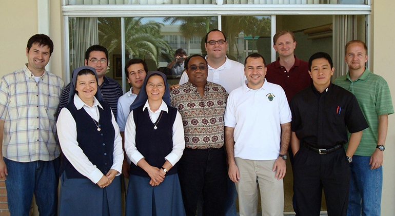 Participants in one of St. John Vianney College Seminary's pre-theology class with pose with Father Matias Hualpa, Matias Hualpa, dean of seminarians, second from right, front, and Father Ferdinand Santos, seminary rector, first from right, front.