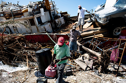People recover items from a beached boat after Hurricane Dorian Sept. 5, 2019, in Marsh Harbor, Great Abaco.
