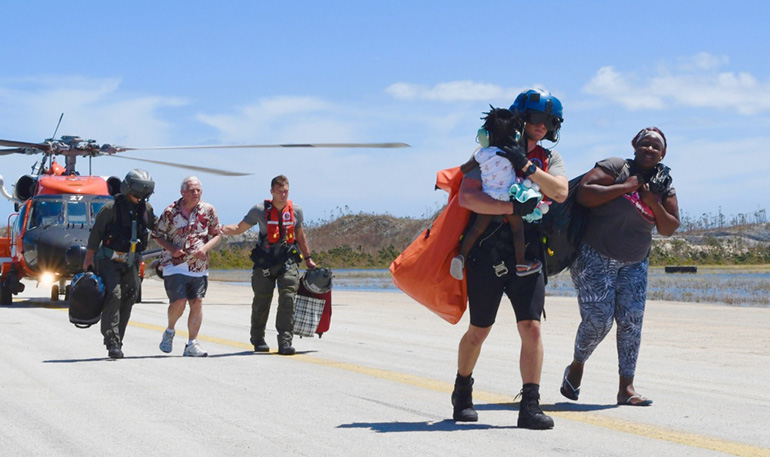 Members of the U.S. Coast Guard conduct search and rescue efforts after the passage of Hurricane Dorian in the Bahamas.