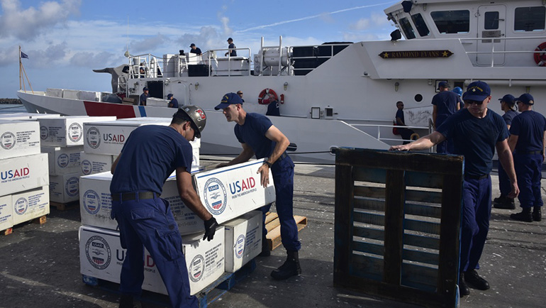 Members of the Coast Guard Cutter Raymond Evans (WPC-1110) offload boxes of supplies from the cutter Sept. 6, 2019 in Nassau, Bahamas, during Hurricane Dorian response efforts. (U.S. Coast Guard photo by Petty Officer 2nd Class Jonathan Lally)